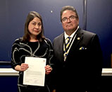 Deputy Secretary of State Luis Borunda presents the Consul General of Peru a letter of condolence to Governor Hillbck-Guzman of the Piura region of Peru