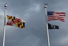 US flag and Maryland flag are at full-staff